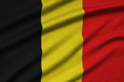 Belgium flag is depicted on a sports cloth fabric with many folds. Sport team banner. Belgium flag is depicted on a sports cloth fabric with many folds. Sport stock photos