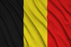 Belgium flag is depicted on a sports cloth fabric with many folds. Sport team banner. Belgium flag is depicted on a sports cloth fabric with many folds. Sport royalty free stock photography