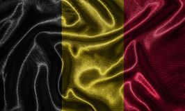 Wallpaper by Belgium flag and waving flag by fabric. Belgium flag - Fabric flag of Belgium country, Background and wallpaper of waving flag by textile stock photo