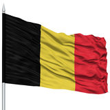 Belgium Flag on Flagpole. Flying in the Wind, Isolated on White Background Stock Images