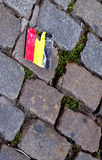 Belgium flag. On the floor pavement in Brussels royalty free stock photo