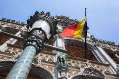 Belgium flag on Grand Place Royalty Free Stock Images