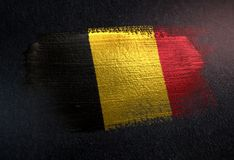 Belgium Flag Made of Metallic Brush Paint on Grunge Dark Wall.  stock photography