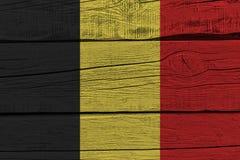 Belgium flag painted on old wood plank. Patriotic background. National flag of Belgium stock illustration