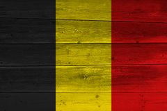 Belgium flag painted on old wood plank. Patriotic background. National flag of Belgium stock photos
