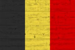Belgium flag painted on old wood plank. Patriotic background. National flag of Belgium royalty free stock photography