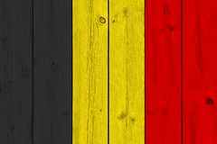 Belgium flag painted on old wood plank. Patriotic background. National flag of Belgium stock images