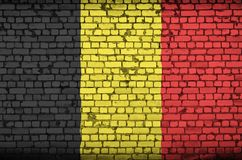Belgium flag is painted onto an old brick wall royalty free illustration