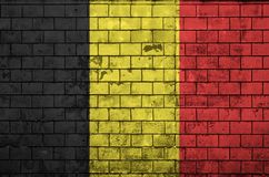 Belgium flag is painted onto an old brick wall stock illustration