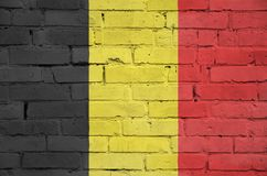 Belgium flag is painted onto an old brick wall stock images