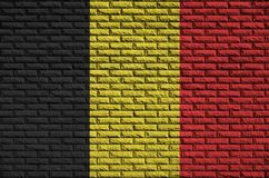 Belgium flag is painted onto an old brick wall stock image