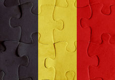 Belgium flag puzzle. Illustration of a flag of Belgium over some puzzle pieces. Its a JPG image Stock Images