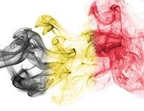 Belgium flag smoke. Isolated on a white background stock photography