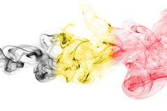 Belgium flag smoke. Isolated on a white background royalty free stock images