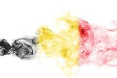 Belgium flag smoke. Isolated on a white background royalty free stock photography