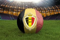 Belgium football team ball on big stadium background with Belgium Team logo competition concept. Belgium flag on ball team tournam. Ent in Russia. Sport Stock Photo