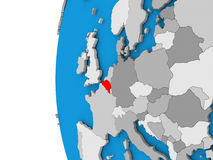Belgium on globe. 3D map of Belgium focused in red on simple globe. 3D illustration Stock Image