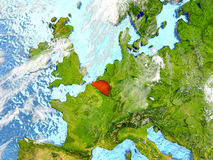 Belgium on map with clouds. Belgium in red on map with detailed landmass texture, realistic watery oceans and clouds above the surface. 3D illustration. Elements Royalty Free Stock Photos