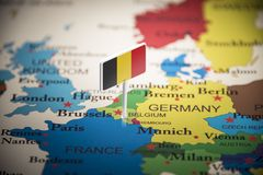 Belgium marked with a flag on the map.  royalty free stock photography
