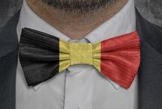 Belgium national flag on bowtie business man suit. Close up stock image