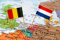 Belgium and Netherlands flags on map. Paper flag pins of Belgium and Netherlands on Europe map. Diplomatic relations concept Royalty Free Stock Image