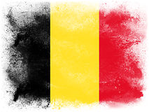 Belgium. Powder paint exploding in colors of Belgium flag isolated on white background. Abstract particles explosion of colorful dust Royalty Free Stock Photography