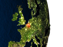 Belgium from space during dusk. Dusk over Belgium highlighted in red with city lights as seen from Earth's orbit in space. 3D illustration with highly detailed Stock Photo
