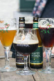 Belgium Straffe Hendrik beers bottles and Brugse Zot beer glasses Stock Photography