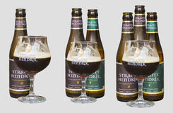 Belgium Straffe Hendrik beers bottles and glass isolated on light background Stock Images