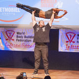Belgium strongman Jimmy Laureys lifts girls on stage Royalty Free Stock Photo