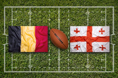 Belgium vs. Georgia flags on rugby field Stock Images