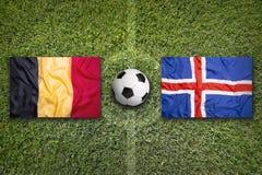 Belgium vs. Iceland flags on soccer field Stock Photo