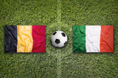 Belgium vs. Italy flags on soccer field Royalty Free Stock Photography