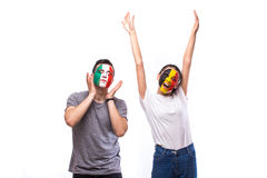 Belgium vs Italy. Football fans of national teams demonstrate emotions: Belgium win, Italy lose. European football fans concept Royalty Free Stock Image