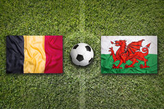 Belgium vs. Wales flags on soccer field Royalty Free Stock Image