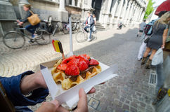 Belgium waffle with chocolate sauce and strawberries Stock Images