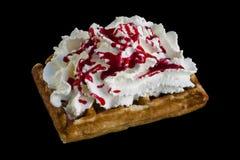 Belgium waffle with cream and strawberry syrup isolated on black background stock image