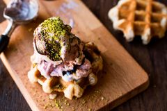 Belgium Waffle with ice cream on wooden surface. Royalty Free Stock Images