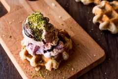 Belgium Waffle with ice cream on wooden surface. Royalty Free Stock Photography
