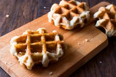 Belgium Waffle with Maple Syrup on wooden surface. Traditional Food royalty free stock photos