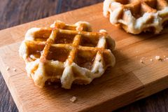 Belgium Waffle with Maple Syrup on wooden surface. Traditional Food royalty free stock image