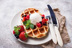Belgium waffles with berries and ice cream. Selective focus stock photos