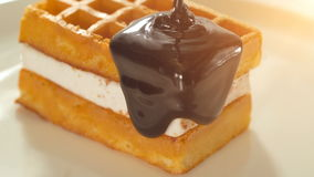 Belgium waffles with melted chocolate stock footage