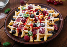 Belgium waffles with raspberries, chocolate and syrup Stock Photos