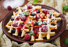 Belgium waffles with raspberries, chocolate and syrup Royalty Free Stock Photos