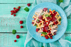 Belgium waffles with raspberries and syrup Stock Photos