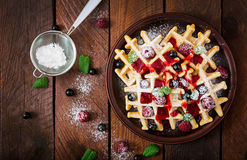 Belgium waffles with raspberries and syrup Stock Photography