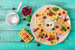 Belgium waffles with raspberries Royalty Free Stock Images