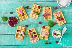 Belgium waffles with raspberries Royalty Free Stock Image