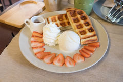 Belgium waffles with strawberries and ice cream Stock Images